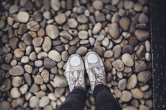 Shoes on stones Royalty Free Stock Photo