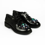 Shoes with stones. Over white Royalty Free Stock Photos