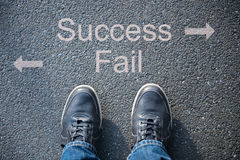Shoes on the street as symbol for success or fail Stock Photography