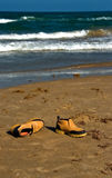 Shoes on a sunny beach Royalty Free Stock Photography