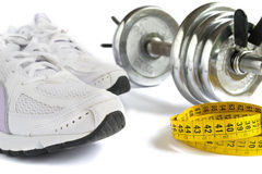 Shoes, tape and dumbbell Stock Photography