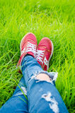 Shoes of a teenager woman on grass field Stock Photo
