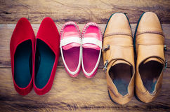 Shoes, three pairs of dad, mom, son - the family concept. Stock Photos