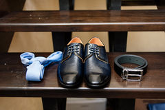 Shoes, tie and on belt the stairs. Groom shoes, tie and on belt the stairs Royalty Free Stock Photo