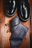 Shoes with tie and cuff. Fashion male accessories. Shoes with tie and cuff Stock Photography