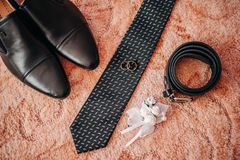Shoes tie leather belt boutonniere for the groom. On the wedding day Stock Images