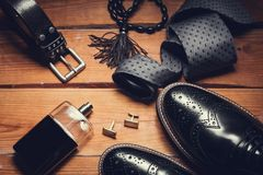 Shoes with tie, perfume and cuff. Men accessories. Shoes with tie, perfume and cuff Royalty Free Stock Images