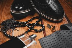 Shoes with tie, perfume and cuff. Men accessories. Shoes with tie, perfume and cuff Stock Photography