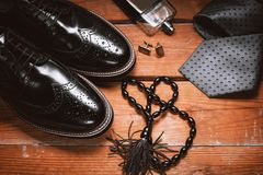 Shoes with tie, perfume and cuff. Men accessories. Shoes with tie, perfume and cuff Stock Image