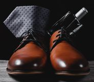 Shoes with tie and perfume. Man`s style. shoes with tie and perfume Royalty Free Stock Photo