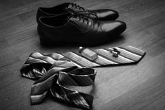 Shoes, tie and perfume. Set men's clothing, shoes and accessories on wooden background Stock Photos