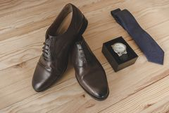 Shoes, tie and watch as accessories to dress elegantly stock photography