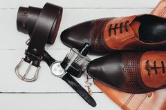Shoes with tie and watch. Mans fashion accessories. Shoes with tie and watch Royalty Free Stock Image