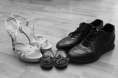 Shoes tied together mom and dad's son. The symbol of family love Stock Photo