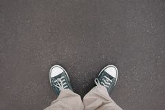 Shoes, trainers, asphalt stock photography