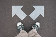 Shoes, trainers - two arrows royalty free stock images