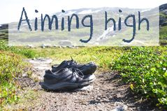 Shoes On Trekking Path, Text Aiming High royalty free stock images