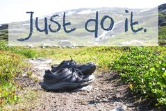 Shoes On Trekking Path, Text Just Do It stock photography