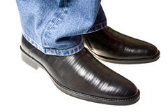 Shoes under jeans Stock Photography