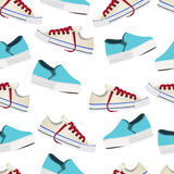 Shoes vector background, seamless pattern. Multicolored slip-on and gumshoes on a white backdrop Stock Photos