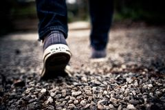 Shoes Walking Feet Grey Gravel Blue Jeans Royalty Free Stock Photo
