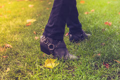 Shoes walking on grass Stock Photography