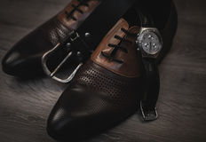 Shoes with watch and belt. Gentleman`s set of accessories. Shoes with watch and belt Royalty Free Stock Photography