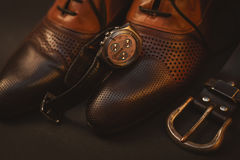 Shoes and watch and belt. Male shoes and watch and belt Royalty Free Stock Image