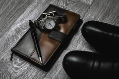 Shoes with watch and notepad. Male accessories. Shoes with watch and notepad Stock Photo