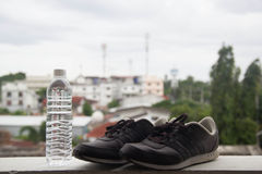 Shoes and water. Ready to go jogging in the morning Royalty Free Stock Images