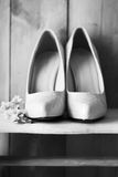 Shoes and wedding rings Stock Photography