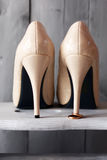 Shoes and wedding rings Stock Image