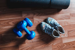 Shoes weights and Mat. The surface of the linoleum to lay the shoes dumbbell Mat Stock Photography