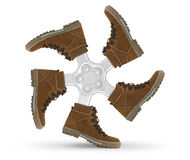 Shoes wheel. Creative concept on white Royalty Free Stock Image