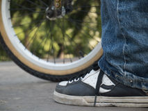 A shoes and a wheel Royalty Free Stock Image