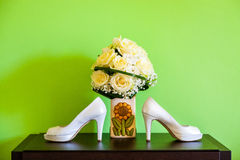 Wedding shoes. Shoes of white wedding on the table Stock Image
