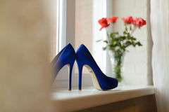 Shoes on Window Sill Royalty Free Stock Image
