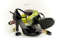 Shoes and wine. Shoes, wine and lipstick on white background Royalty Free Stock Photos
