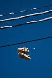 Shoes on wire Royalty Free Stock Photos