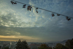 Shoes on a wire at the Prague Metronome Royalty Free Stock Photos