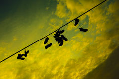 Shoes on a wire at the Prague Metronome Royalty Free Stock Images