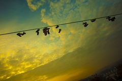 Shoes on a wire at the Prague Metronome Royalty Free Stock Photo