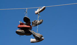 Shoes on a wire Royalty Free Stock Photos