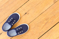 Shoes on wooden background Royalty Free Stock Photo