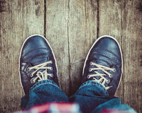Shoes on wooden floor from above. Blue shoes on wooden planked floor from above Stock Photo
