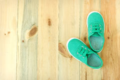 Shoes on a wooden floor. Royalty Free Stock Images