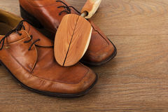 Shoes on a wooden floor Royalty Free Stock Photos