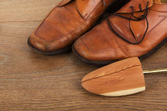 Shoes on a wooden floor Stock Image