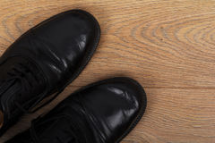 Shoes on a wooden floor Royalty Free Stock Images