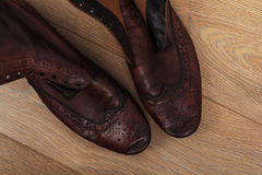 Shoes on a wooden floor Royalty Free Stock Photo